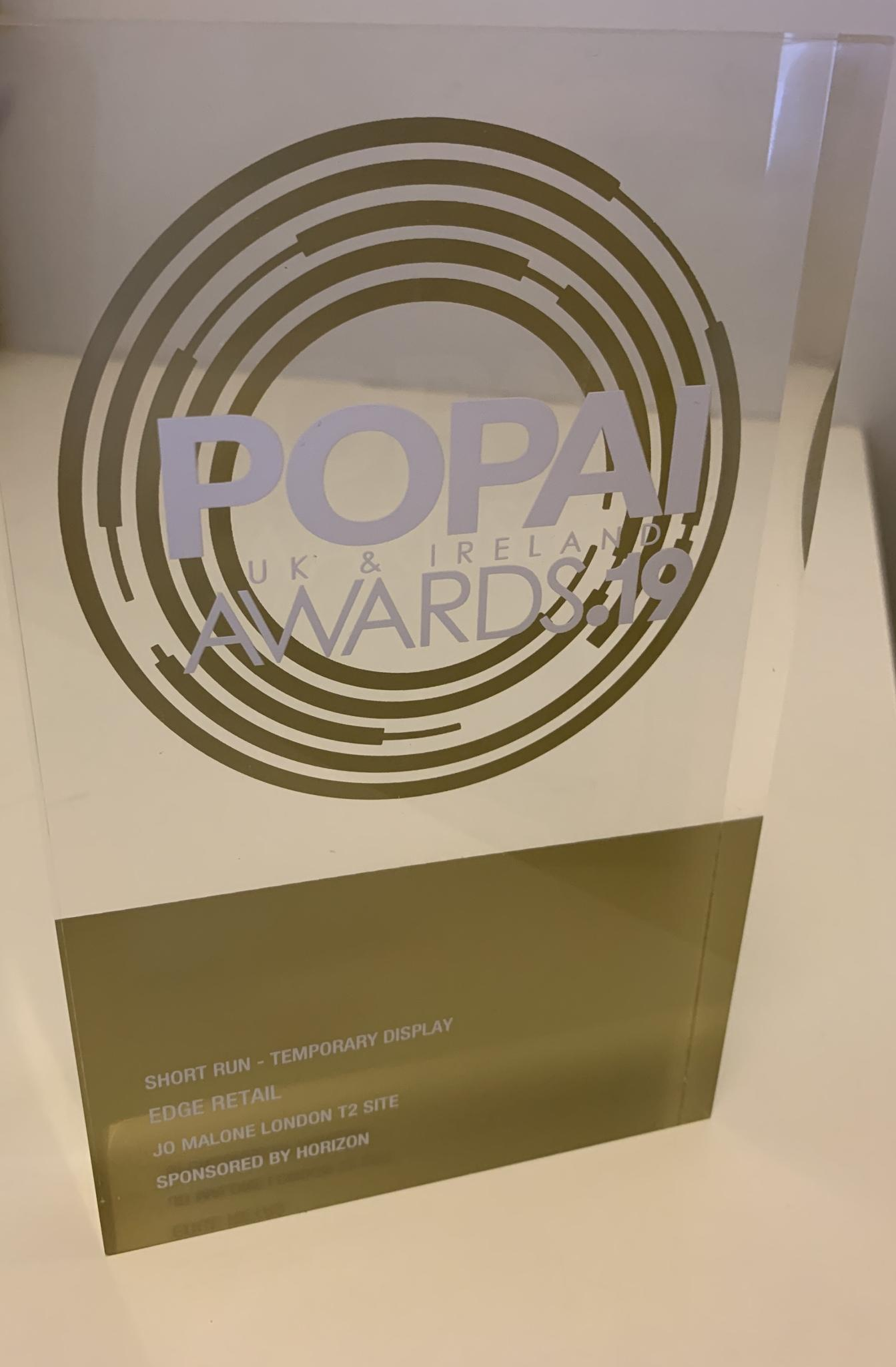 Gold POPAI award trophy